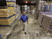 Randy Stepherson at Superlo's warehouse on American Way. His six stores rank fifth in market share in Memphis, but Kroger still dominates.