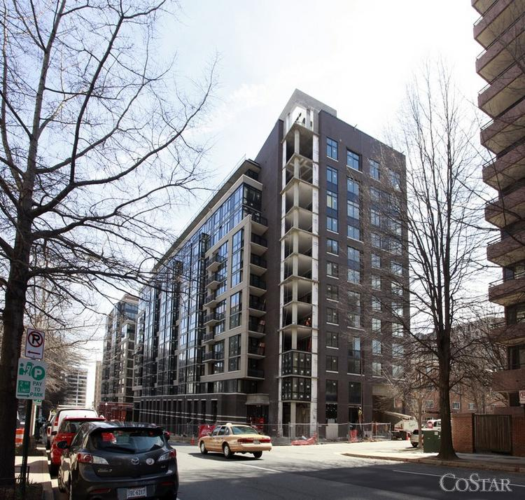 Georgetown University is considering leasing The JBG Cos.' Slate apartment building in Rosslyn for use as housing for its graduate students.