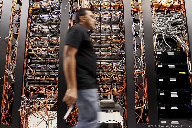 A Symantec employee walks past patch panels at the company's headquarters in Mountain View. Symantec on Tuesday reported a quarterly earnings forecast that missed Wall Street's expectations.