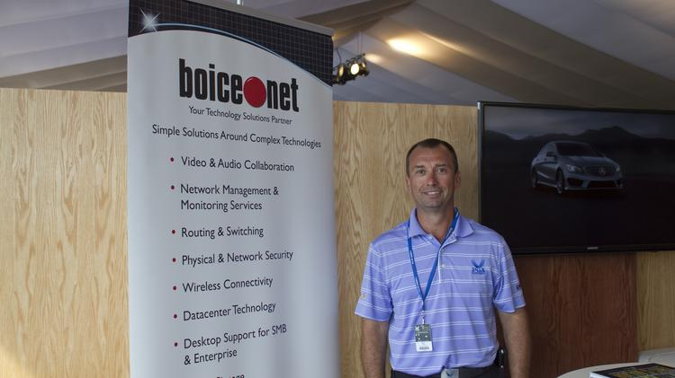 Bill Hall, CEO of Boice.net, stands in his PGA suite on Thursday.