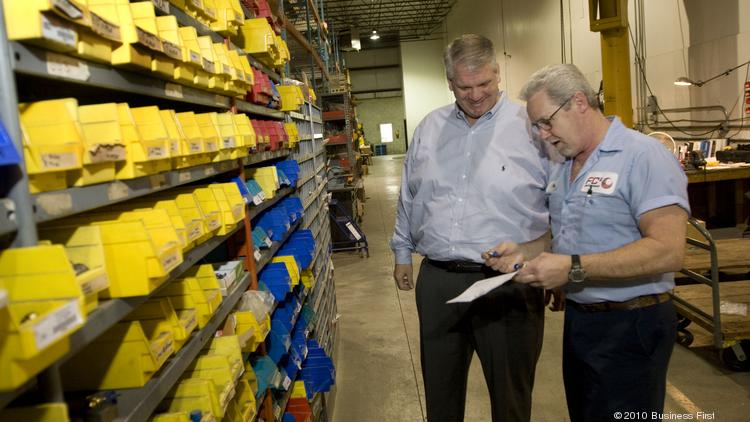 """FCX Performance President Charles Hale, left, says the company is """"an acquirer of choice"""" for others in the consolidating valve and pump industry."""