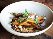 Roasted carrots with black mole and Oregon cotija cheese is one of the small-plate offerings at Bellevue restaurant 99 Park.