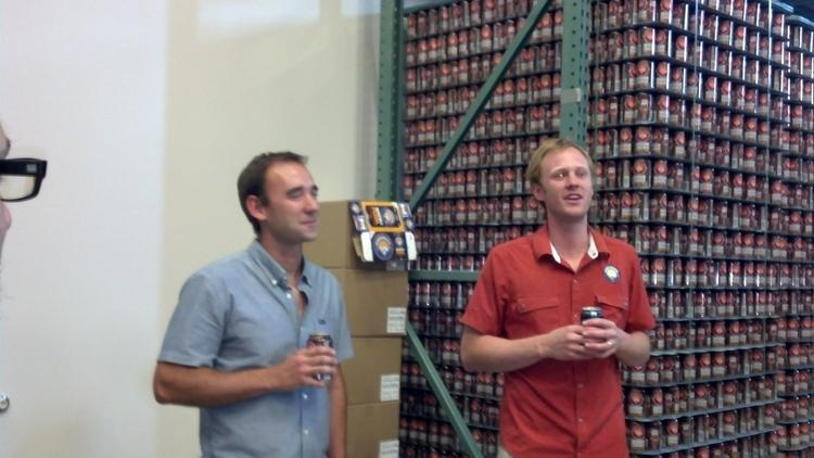 Denver Beer Co. co-owners Patrick Crawford and Charlie Berger speak to a small crowd at the official opening of their new production facility in north Denver on Thursday, Aug. 7.