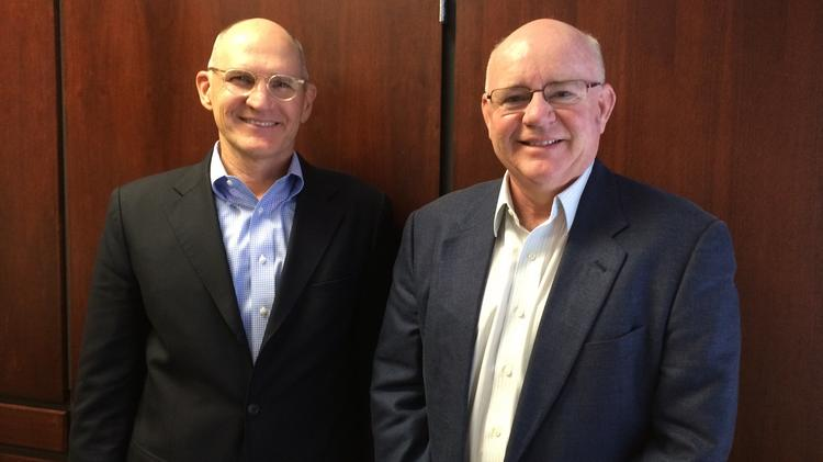 All Aboard Florida executives Mike Reininger, left, and Don Robinson talked with Orlando Business Journal about where things stand on the $2.3 billion intercity passenger rail project.