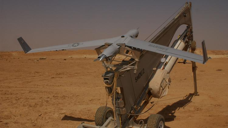 A U.S. Marines ScanEagle on the catapult prior to launch during an earlier mission in Iraq. The aircraft, with a 10-foot wingspan, primarily performs surveillance duties, and can remain airborne for 10 hours.