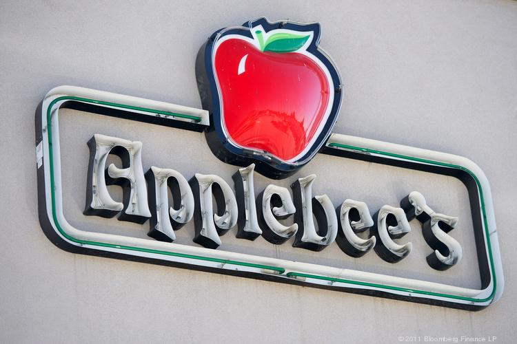 Signage for a DineEquity Inc. Applebee's is displayed outside of the restaurant in Redwood City, Calif., in this 2011 file photo from Bloomberg. Applebee's is advertising for managers and other staff to open the company's first Hawaii restaurant, near Pearl Harbor.