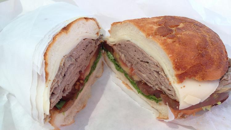 Italian roast tri-tip sandwich with provolone cheese at Italian Delicatessen and Fine Foods in Elk Grove.
