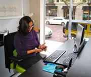 Michele Morgan checks an incoming text at the Accelerate Winter Park location.