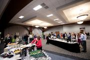 Attendees mingle while enjoying a healthy breakfast at the awards event.
