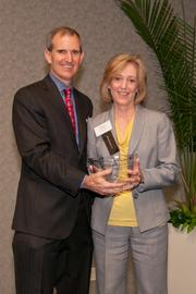 John Sinclair, market president of Humana of Ohio, presents the winner's award in the category of 5,000 or more employees to Nancy Garrison, director of human resources for TriHealth. Humana was a presenting sponsor for the event.