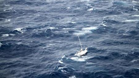 A Matson Inc. crew rescued three men from this sailboat in the Pacific Monday morning.