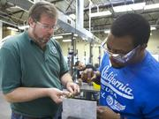 Instructor Jason Buck (left) helps student Evan Jackson of Marysville with a drilling project at the Washington Aerospace Training and Research Center.
