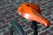 Ben Franz-Knight's bicycle seat is a Selle An-Atomica Titanico X Model, handmade of natural leather in Wisconsin. He likes it because it provides a little suspension.