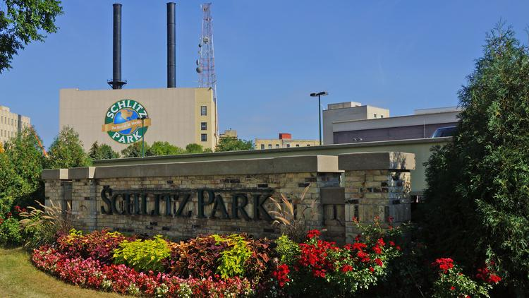 Schlitz Park is north of the Milwaukee River.