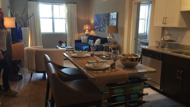 A furnished model two-bedroom unit at Crescent Bayshore. This model is also painted, while units come with standard beige walls.