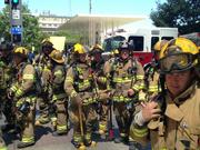 Dallas/Fire Rescue firefighters waits to see if they're needed Tuesday afternoon inside the Comerica Tower.