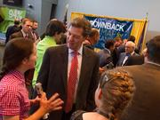 Gov. Sam Brownback greets supporters after a Tuesday afternoon speech at Wichita Area Technical College.
