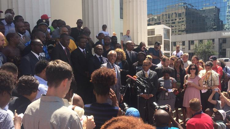 Al Sharpton speaks at the Old Courthouse in downtown St. Louis on August 12.