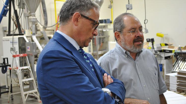 Fritz Paks owner Gabriel Ojeda (right) takes Ex-Im President and Chairman Fred Hochberg on a tour of the company's 30,000-square-foot facility.