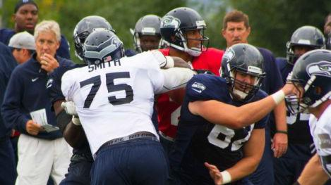 D'Anthony Smith, No. 75, at Seahawks practice on Tuesday. Smith was one of several Seahawks who job shadowed Starbucks employees in June, and on Tuesday, Starbucks employees got to see the Seahawks at their job.