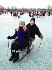 "Seattle philanthropists Paula (left) and Bill Clapp recently visited China's capital city, where they tried the local sport of ""ice chairing."""