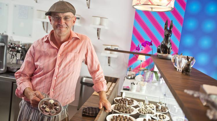 Chef Timothy Woods at the new Timothy Adams Chocolates shop in downtown Palo Alto. Click through the photos for a demo of how the gourmet bonbons are made each day.