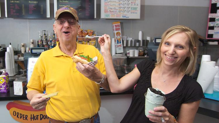 The late Harry Coley goofs around with his daughter, Sydney Berglund, at Wild About Harry's off Knox Street.