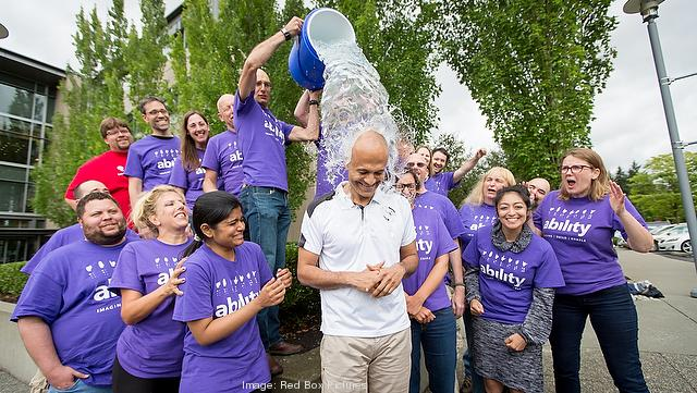 Microsoft CEO Satya Nadella gets a bucked of ice dumped over his head Wednesday in an effort to recognize and support ALS research and he also challenged Jeff Bezos of Amazon and Larry Page of Google to do the same.