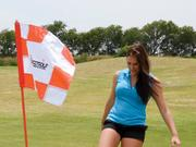 Mansfield National Golf Club's Leah Martinek demonstrates how to putt in FootGolf.