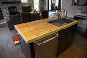 The house's kitchen island top is made from recycled wood.
