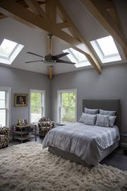 Even more natural light is used in the master bedroom in David and Thuy Smith's home.
