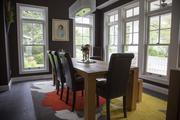 The Active House USA's dining room features an abundance of natural light with energy-efficient windows.
