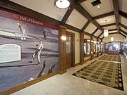 The Hall of Champions at Cherry Hills Country Club, featuring the iconic photo of Arnold Palmer throwing his hat in the air after he staged a huge comeback to win the U.S. Open at Cherry Hills in 1960.