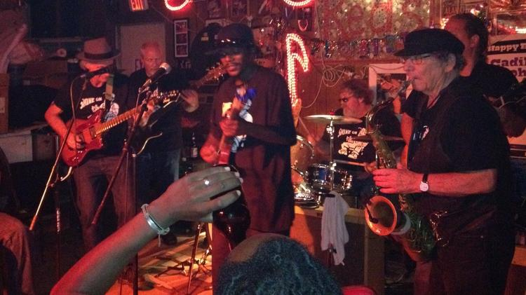 """Anthony """"Big A"""" Sherrod leads the band in Red's, a juke joint in Clarksdale, Miss., where excessive security has contributed to plummeting attendance at the Sunflower River Blues & Gospel Festival."""
