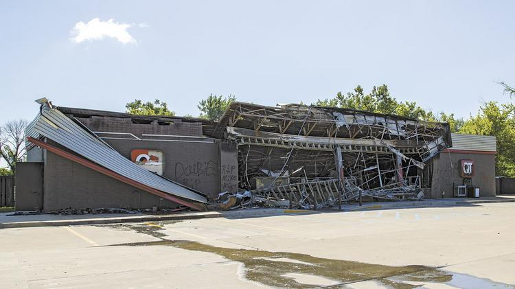 The QuikTrip on West Florissant Ave. burned to rubble Sunday night after looters broke in and stole goods.