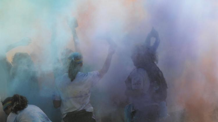 Runners are showered with colored corn starch during The Color Run, as well as after in a color-filled dance party.