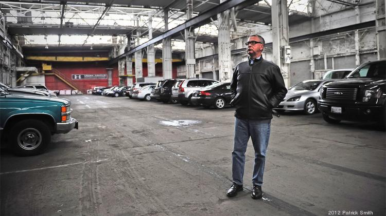 Ed Hale stands inside a warehouse that is part of the waterfront site he has listed for sale.