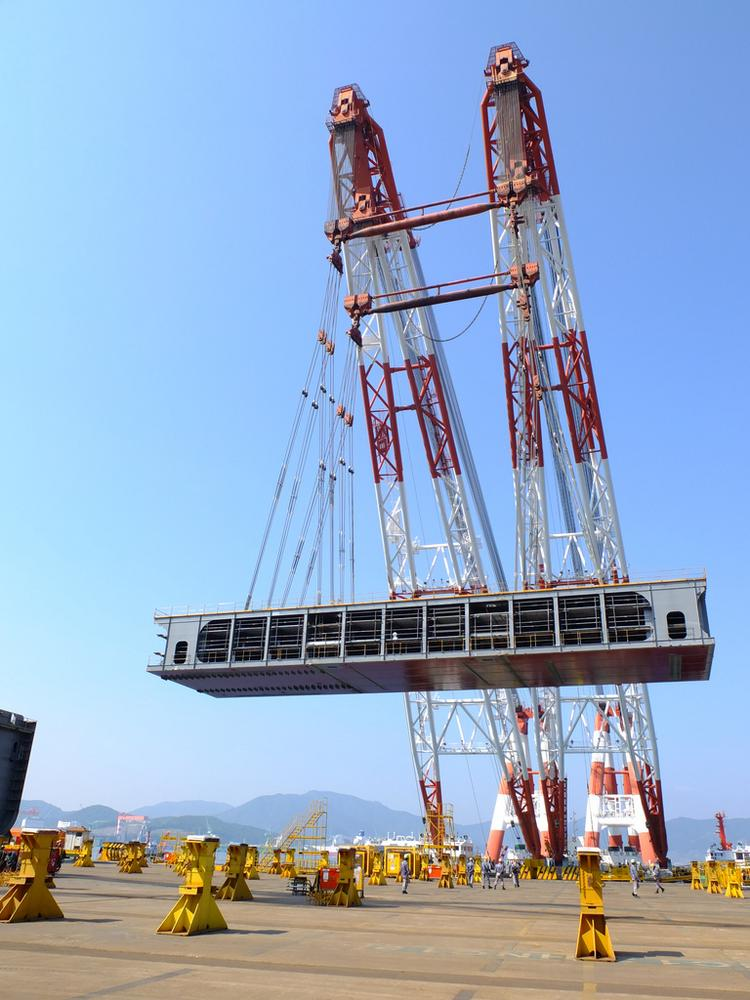 Shell is moving forward on two significant offshore projects, including the Prelude FLNG facility. Pictured: First floating crane lift of a block into to the Green Dock 3.The substructure is built by connecting large steel sections, known as mega blocks, together. The keel is the first of the mega blocks to be positioned in the dry dock.