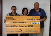 Hawaiian Telcom CEO Eric Yeaman, left, and IBEW 1357 Business Manager Scot Long, right, present a check for $115,000 to Aloha United Way President and Chief Professional Officer Kim Gennaula. All funds were raised by Hawaiian Telcom employees.