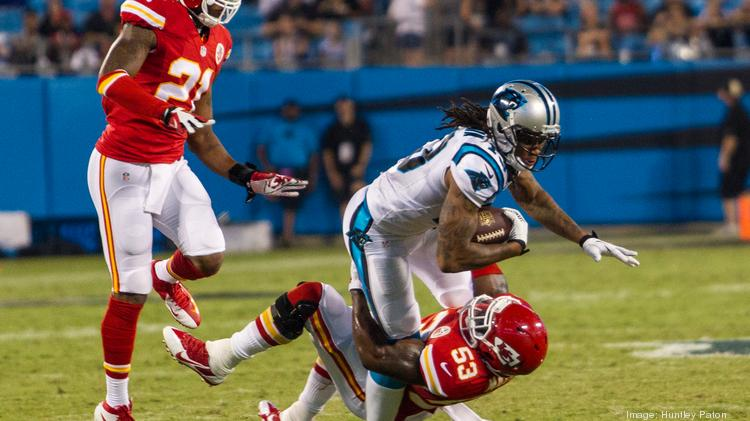 Panthers wide receiver Kelvin Benjamin gets dragged down by the Chiefs' Joe Mays after catching a pass across the middle. The Carolina Panthers beat Kansas City 28-16 in a preseason game on Aug. 17.