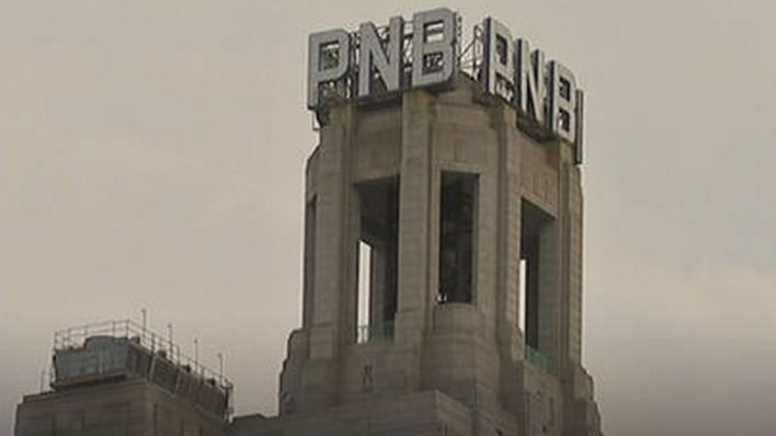 Get a good look at the 16-foot PNB letters a top a building at One South Broad Street, they won't be there for long.