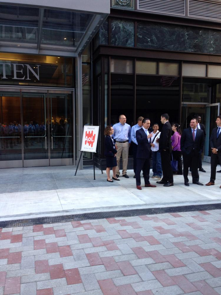 Executives and gather for the first batch of workers from AOL to enter the renovated Burnham Building in Downtown Crossing.