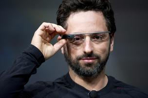 Sergey Brin, co-founder of Google Inc., wears Project Glass internet glasses while speaking at the Google I/O conference. Google announced that the device will be modular to accomodate prescription lenses, and debuted a slew of 3rd party apps this week.