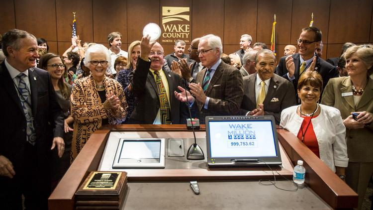 Wake County Commissioner Phil Matthews holds up a symbolic push light at the Wake County Commissioners Board Meeting on Aug. 18 that signified the countdown of Wake County's 1 millionth resident. Wake County, one of the fastest-growing counties nationwide, has an estimated population of about 974,289 as of July 1, 2013. The county is poised to add another digit, with the 1 millionth resident calculated to be added by Friday Aug. 22.