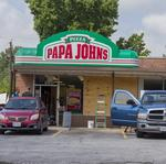 The mystery woman who defended Papa John's on West Florissant