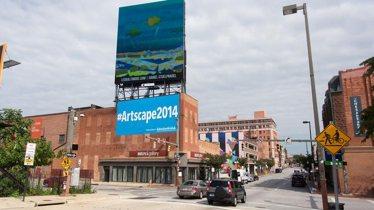 A digital billboard displays a mix of advertising and art at Charles and Lanvale streets in Baltimore.