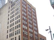 The 15 Building (pictured) is across the street from the Plymouth Building, which the same developer is buying to convert into a new luxury Conrad Hotel.