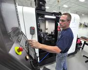Robert Spatz services a machine at Federated Precision in Deerfield Beach.