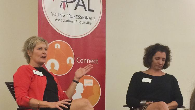 """Cathe Dykstra, chief possibility officer, president and CEO at Family Scholar House, at left, and Maggie Payette Harlow, owner of Signarama Downtown and Transworld Louisville, spoke to a crowd of more than 50 at YPAL's """"S#!* I Wish I Knew"""" event."""