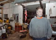 Peter Stone, owner of PEMS, standing where it all began--a shed on his parents' property (which he now owns)